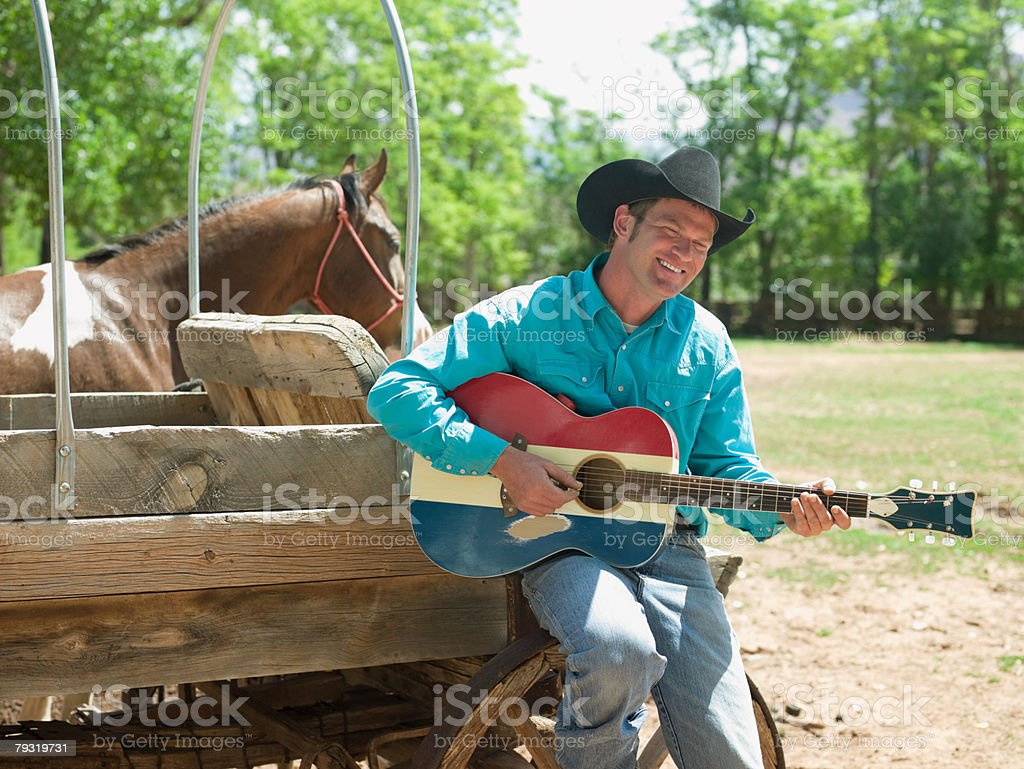 Cowboy with a guitar royalty-free stock photo