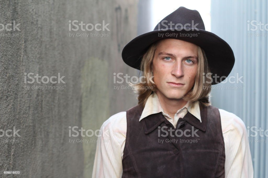 Cowboy with a hat looking sternly stock photo