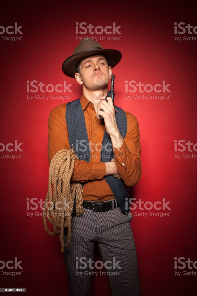 cowboy with a pistol, a gold miner adventure guy in a hat with a gun