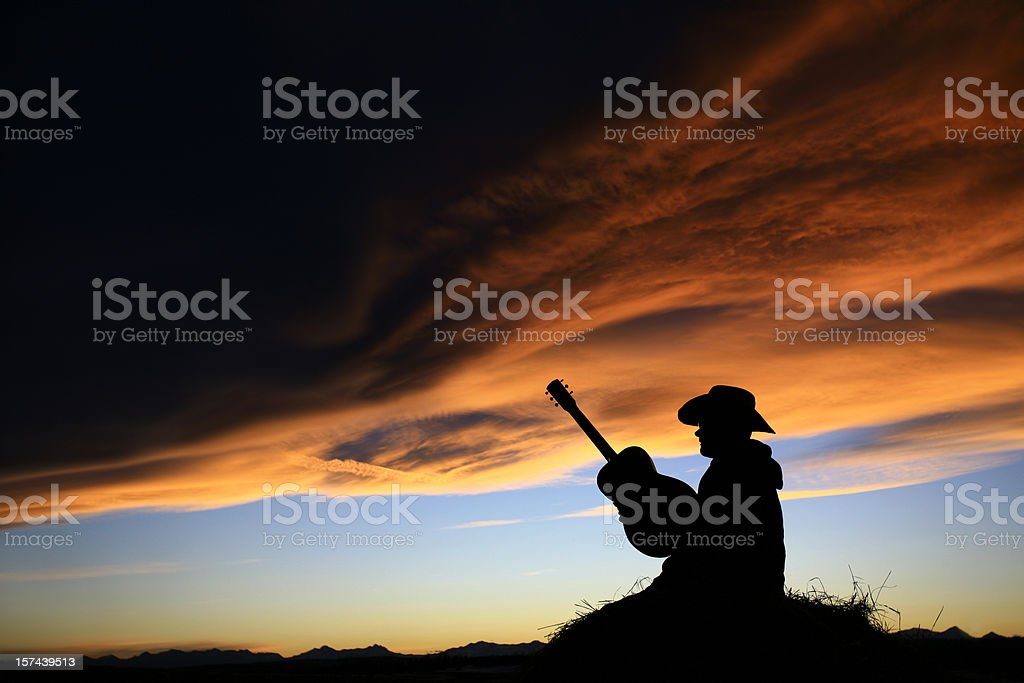 Cowboy with Guitar Silhouette stock photo