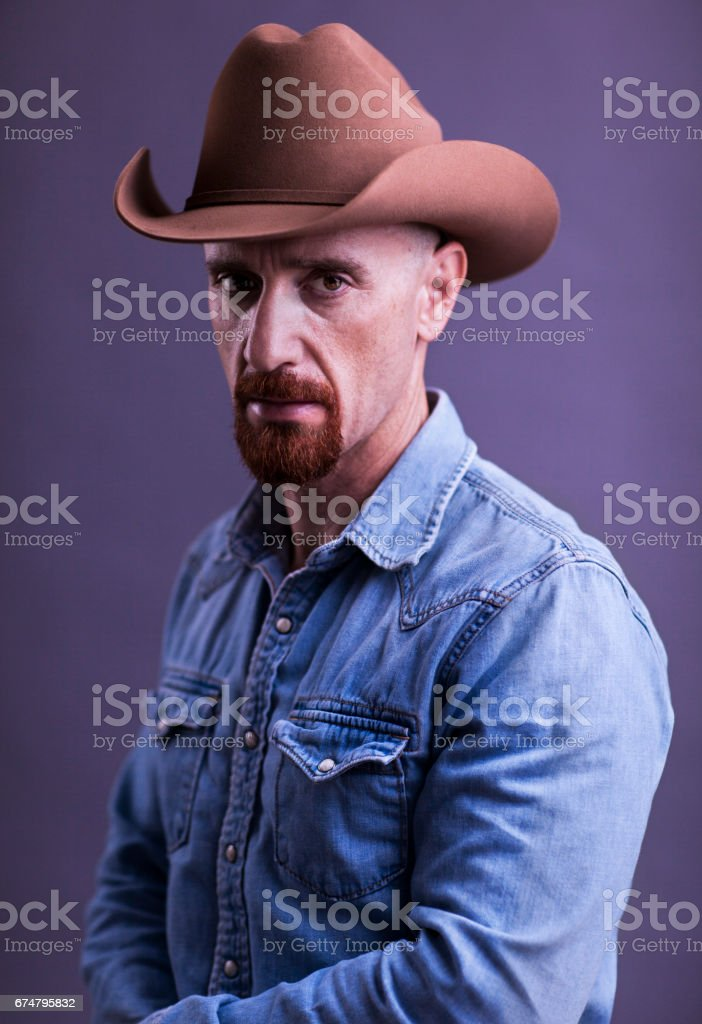 Cowboy with Red Goatee in Blue denim chambray shirt and Stetson Cowboy hat stock photo
