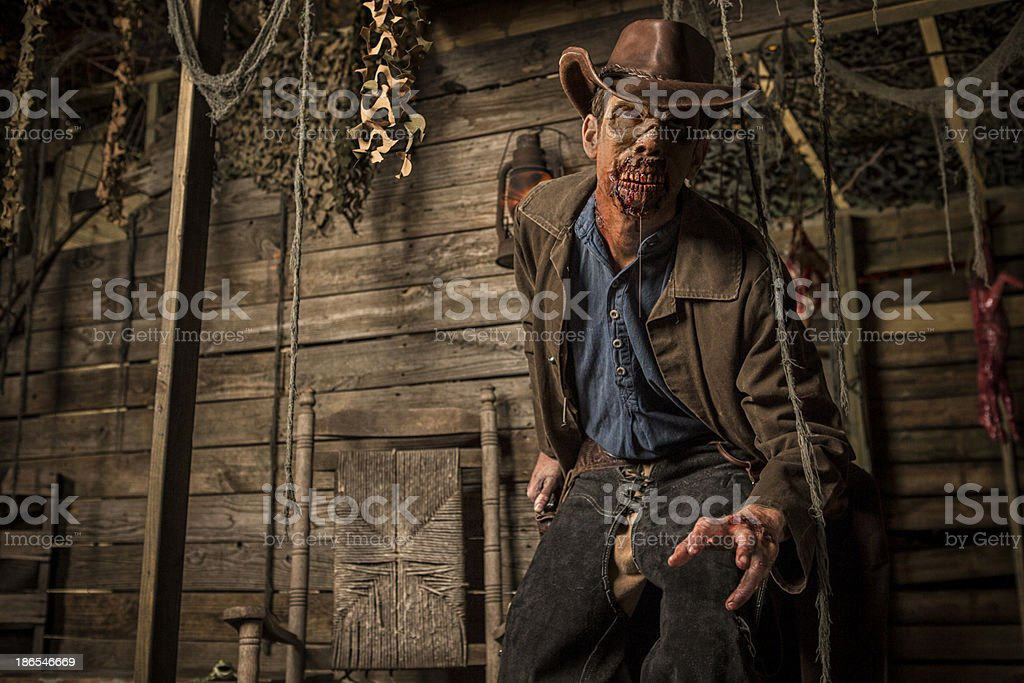 Cowboy Zombie going for his gun stock photo