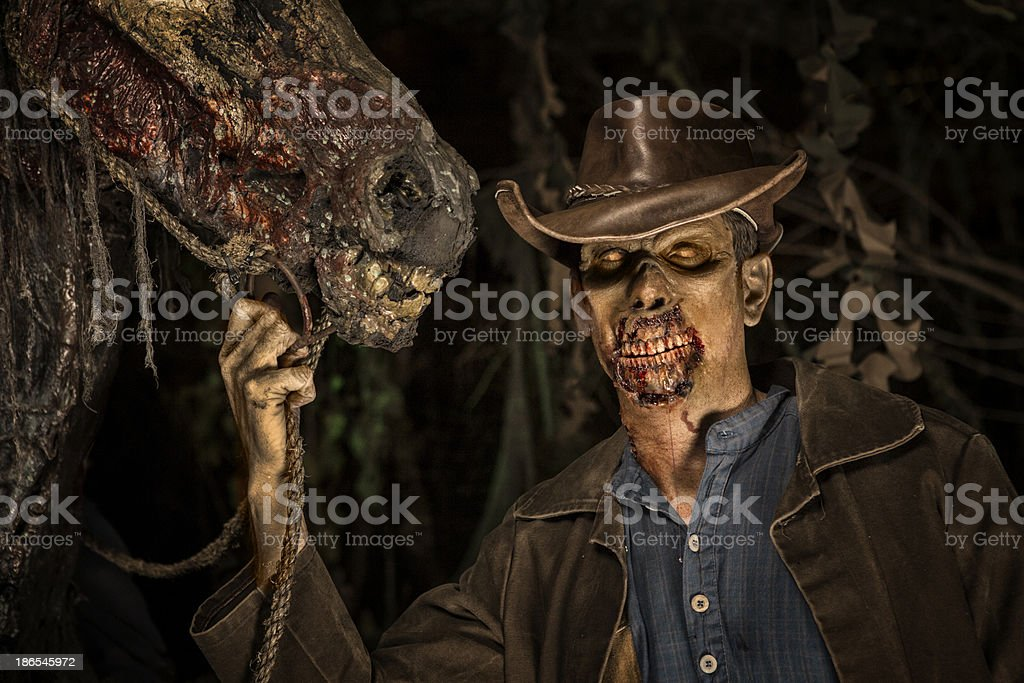 Cowboy Zombie with his horse stock photo
