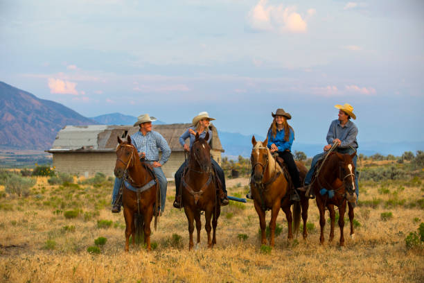 Cowboys and Cowgirls on Horseback in Utah stock photo
