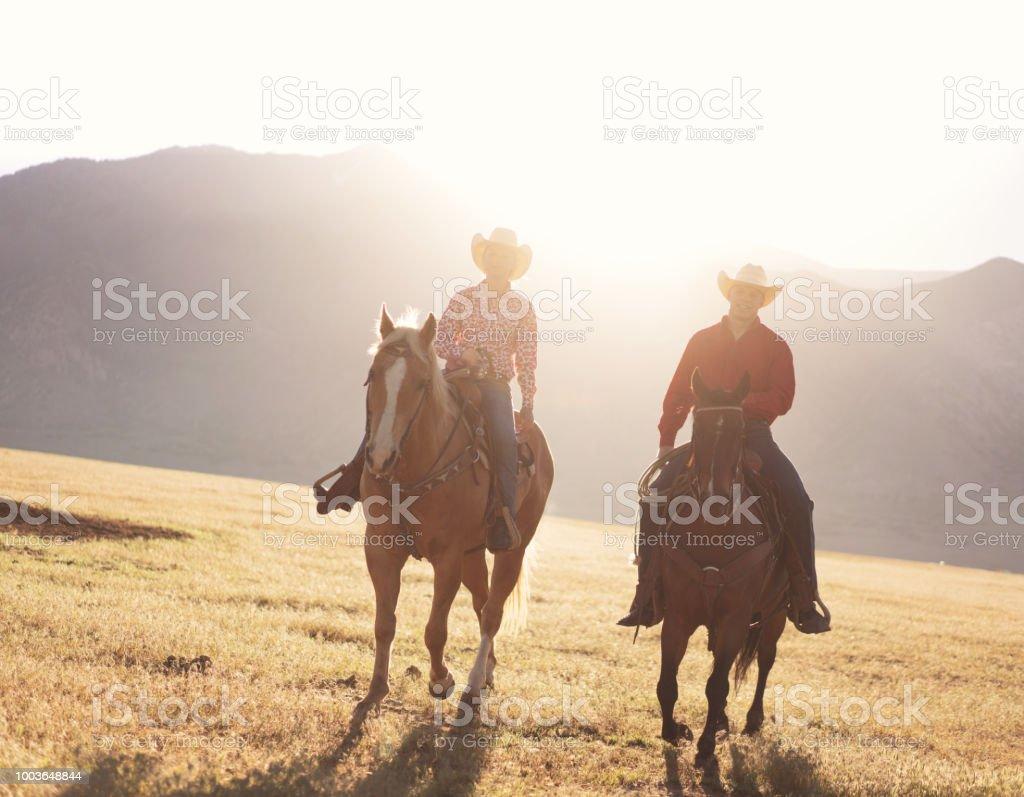 Cowboys Horseback Riding At Sunrise Stock Photo Download Image Now Istock