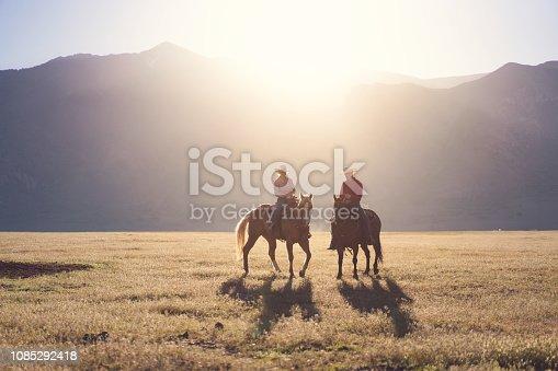 Cowboys Horseback Riding at sunrise