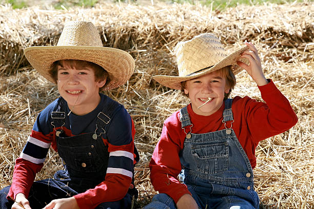 Cowboys  bib overalls boy stock pictures, royalty-free photos & images