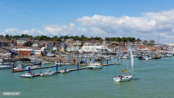 Cowes harbour Isle of Wight with boats and blue sky