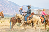 Cowgirl and cowboy congratulate each other while on horseback