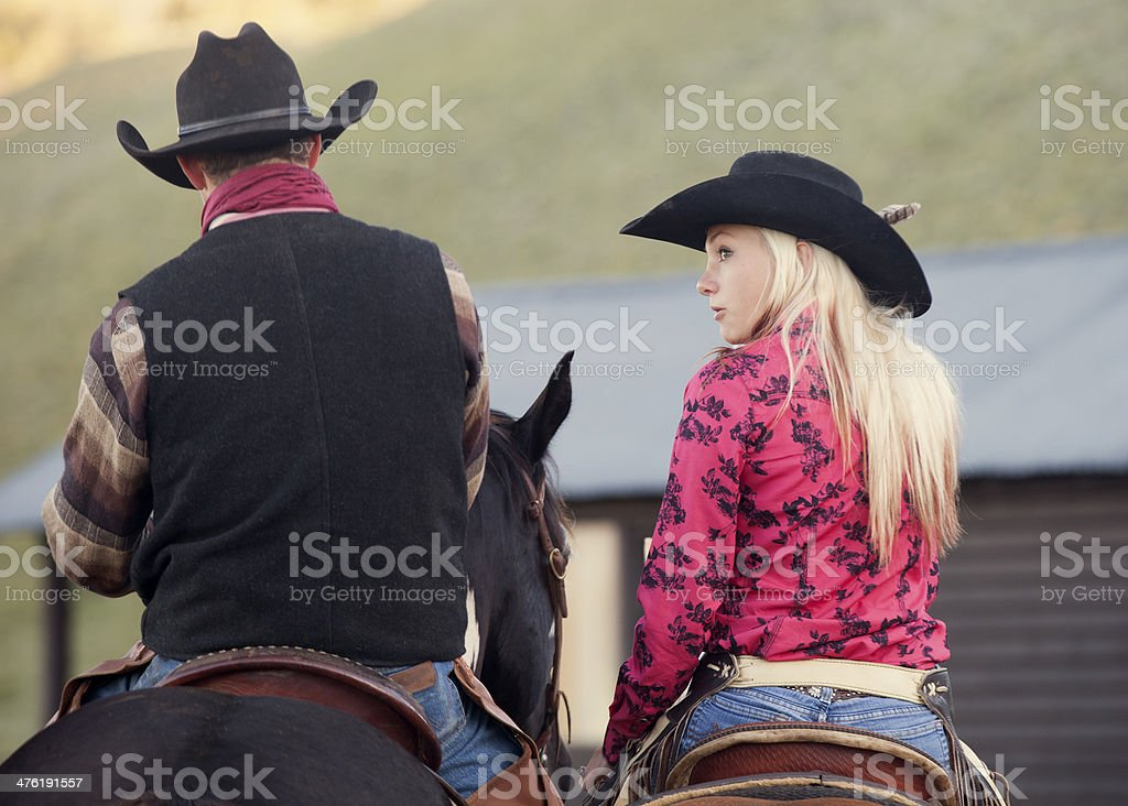Cowgirl and Cowboy on Horseback royalty-free stock photo