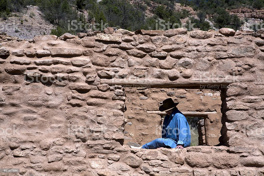 Cowgirl at the Ruins royalty-free stock photo