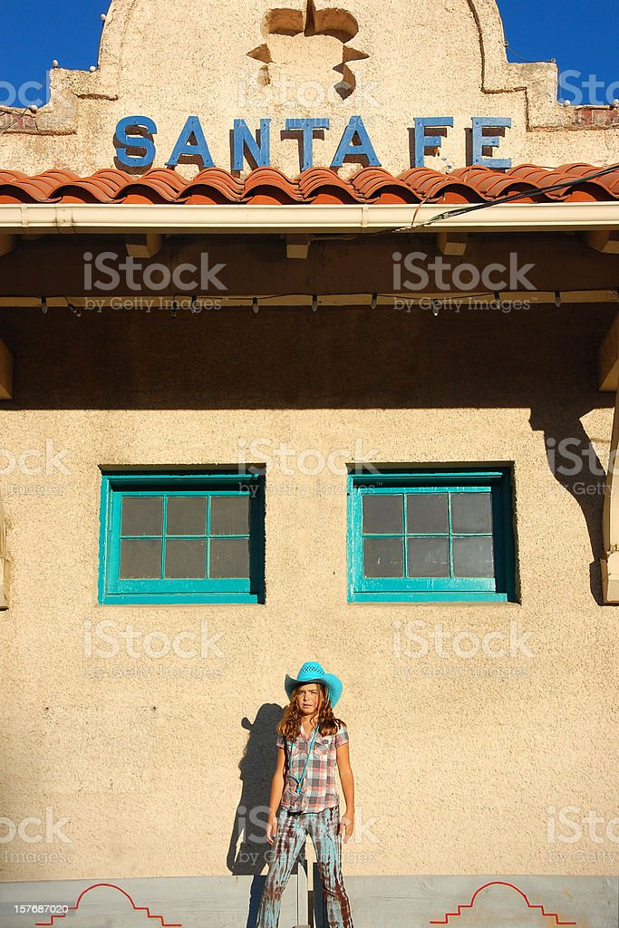 Cowgirl at the Train Depot stock photo