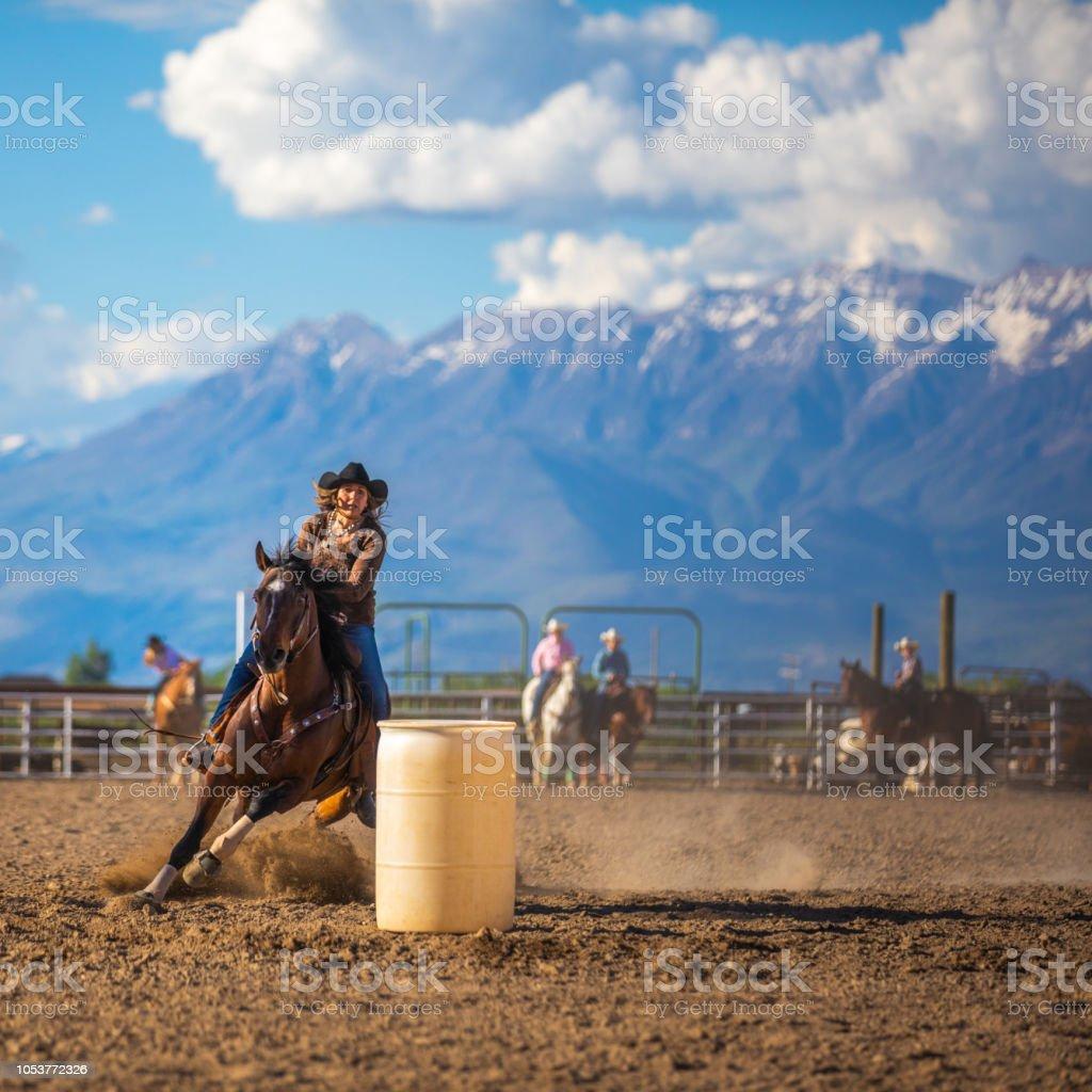 Cowgirl barrel racing rodeo stock photo