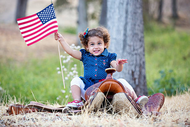 Cowgirl Cutie with American Flag stock photo