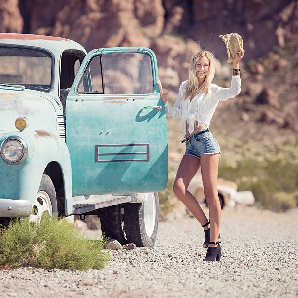 cowgirl fashion, beauty with her oldtimer - western town stock photos and pictures