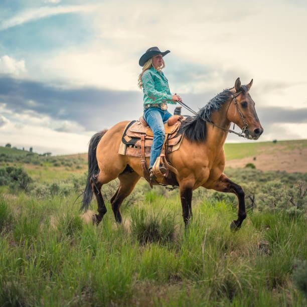 Cowgirl horseback riding picture id1004459866?b=1&k=6&m=1004459866&s=612x612&w=0&h=slrh9n zsrekecyvflnihkv8dbuzlyktcrb0ln3wcb8=