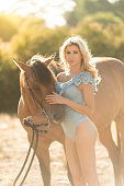 istock Cowgirl In A Sexy Outfit Riding Her Horse 819438160