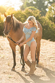 istock Cowgirl In A Sexy Outfit Riding Her Horse 819438192