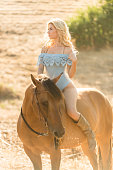 istock Cowgirl In A Sexy Outfit Riding Her Horse 819438550