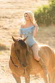 istock Cowgirl In A Sexy Outfit Riding Her Horse 819440708