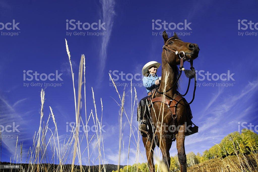 cowgirl landscape sky stock photo