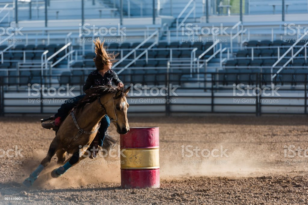 Cowgirl Moving At Speed Around Barrel Racing At Rodeo Hair