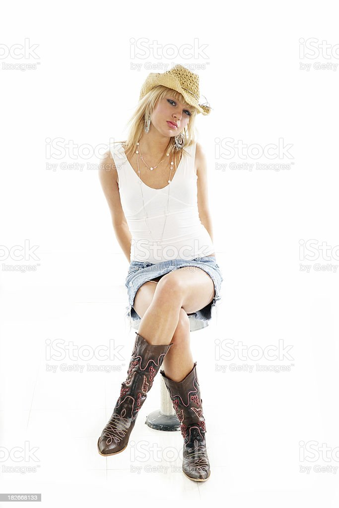 Cowgirl on a bench royalty-free stock photo