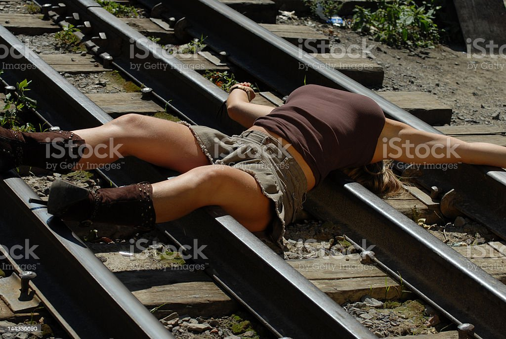 Cowgirl on a railroad 3 stock photo