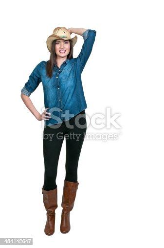 Beautiful young country girl woman wearing a stylish cowboy hat