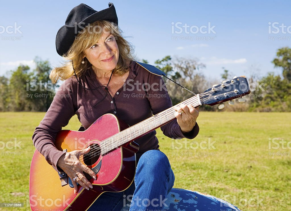 Cowgirl Plays a Tune royalty-free stock photo