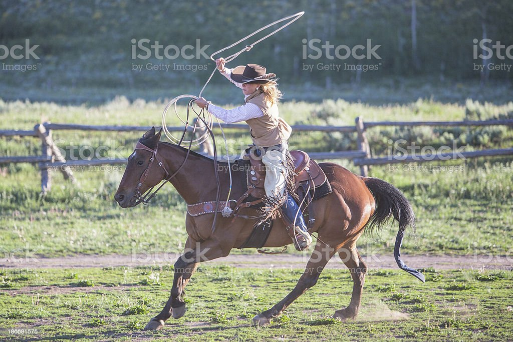 Cowgirl practising lasso stock photo
