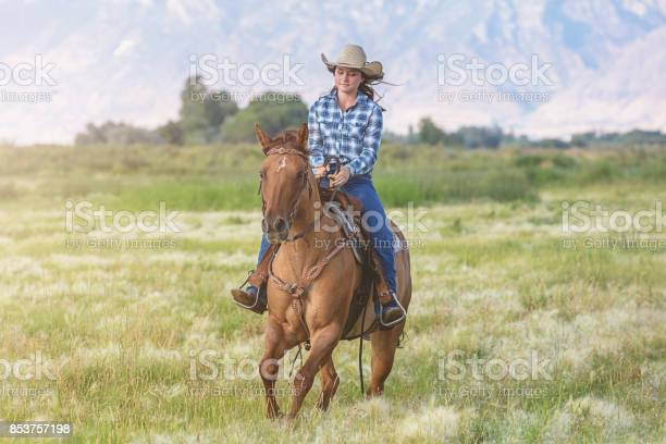 Cowgirl riding her horse along ranch grassland picture id853757198?b=1&k=6&m=853757198&s=612x612&h=gbfcx7rwzmojhtkzud3lfu63ez cfajgm75nlgfrlng=