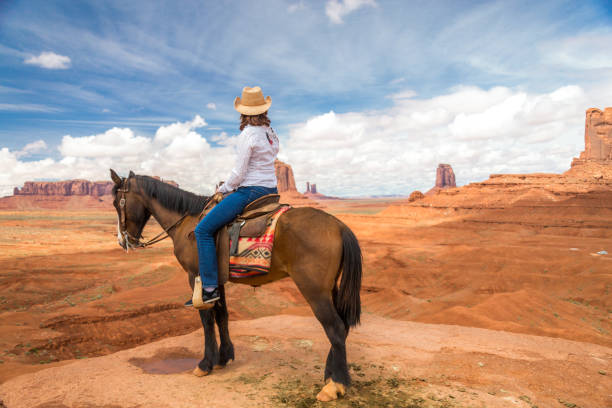 Cowgirl riding horse in monument valley navajo tribal park in usa picture id1172283231?b=1&k=6&m=1172283231&s=612x612&w=0&h=c2prmaeot9fgj7yfwflcetk7ybjsqrobhs782l5mgxs=