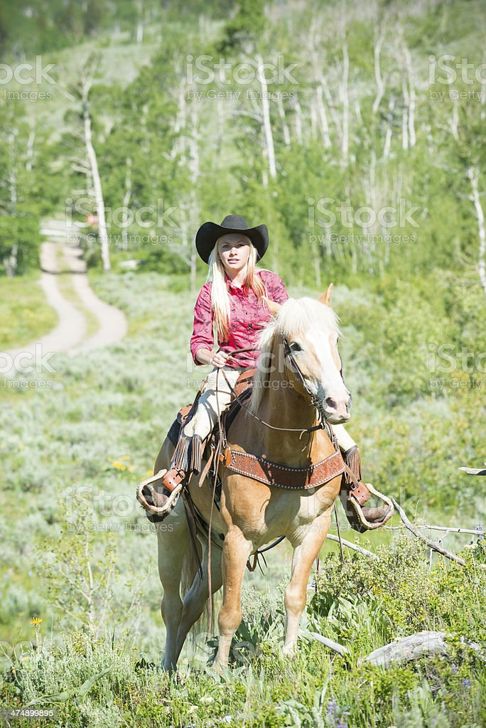 Cowgirl riding out royalty-free stock photo
