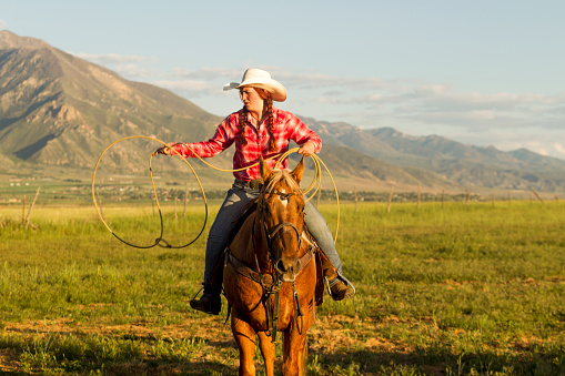 cowgirl roping lasso and ride at santaquin Salt lake City SLC Utah USA