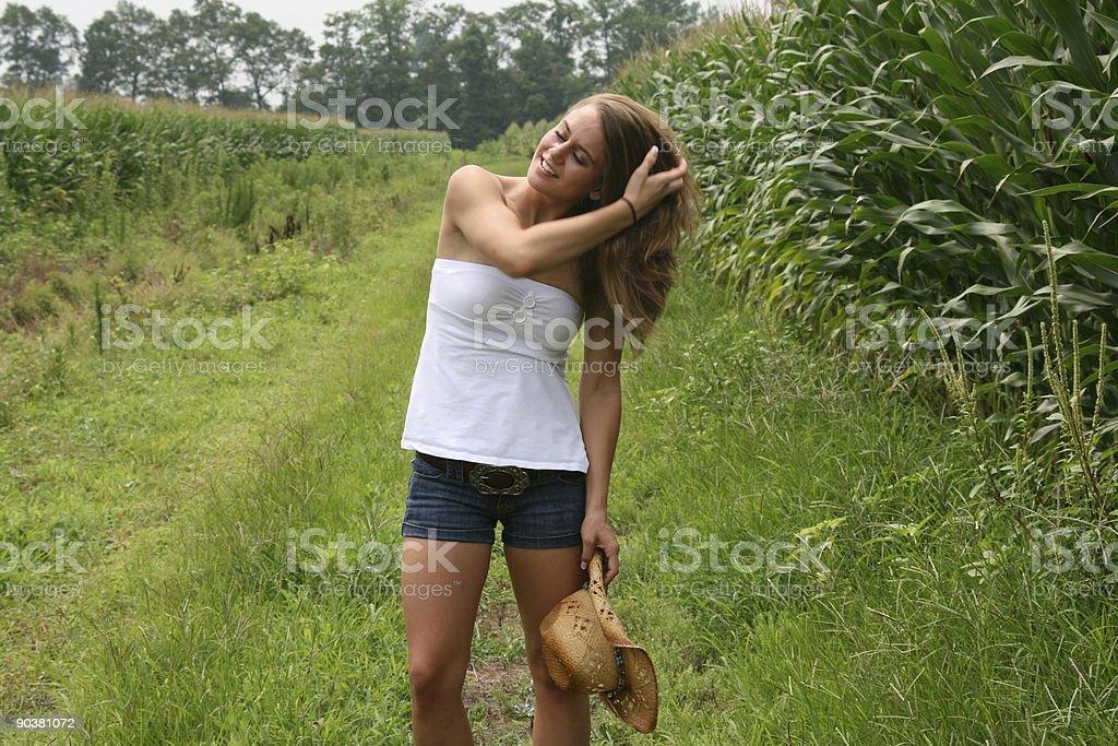 Cowgirl Running Fingers Through Hair stock photo