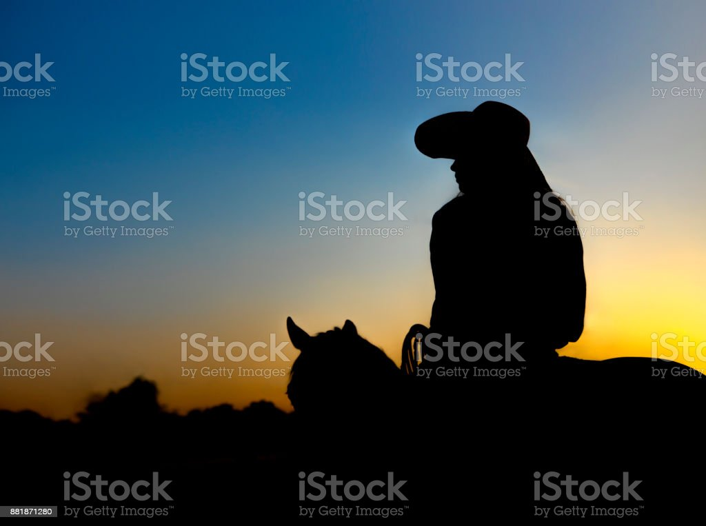 Cowgirl Silhouette stock photo