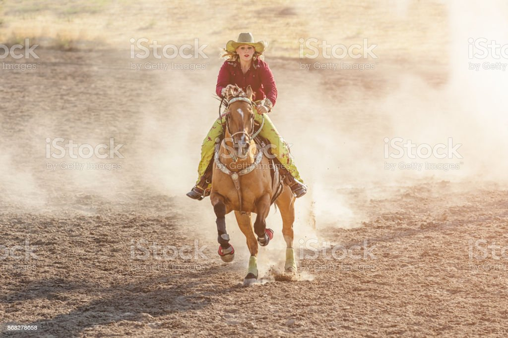 Cowgirl Speeding Barrel Racing Competition stock photo