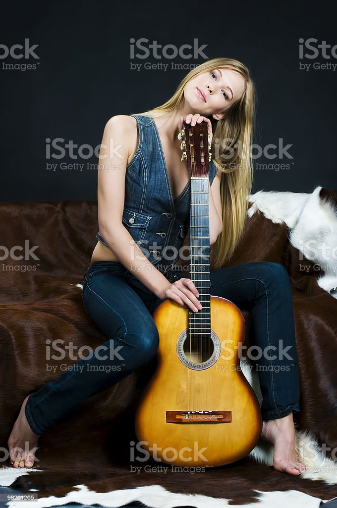 Cowgirl with guitar royalty-free stock photo