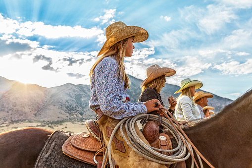 Cowgirls and Cowboy line up waiting to go for a ride in the morning