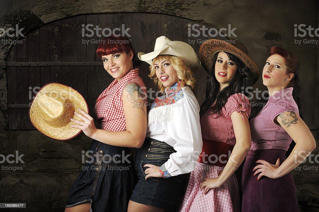 Cowgirls chorus line against barn door stock photo