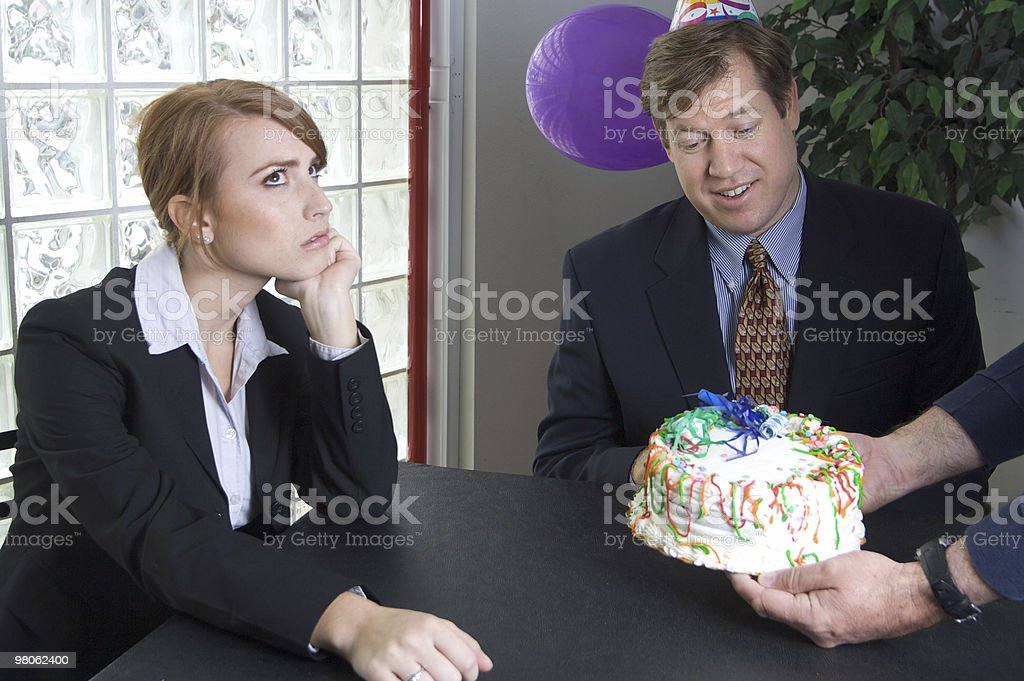Co-worker Annoyed at a Birthday Cake royalty-free stock photo