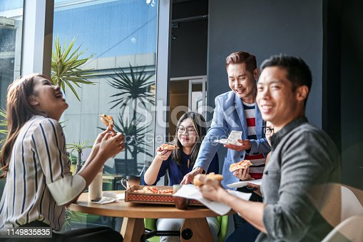 690855708istockphoto Coworker eating while having discussion 1149835835