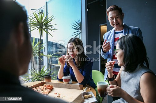 istock Coworker eating while having discussion 1149836598