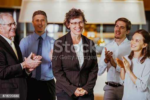 istock Coworkers Applauding to Happy Senior Businesswoman 878220330