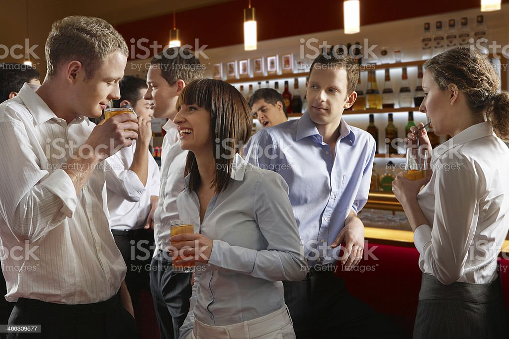 Coworkers at bar stock photo