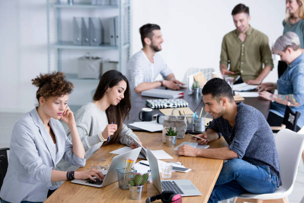Coworkers brainstorming ideas for project stock photo