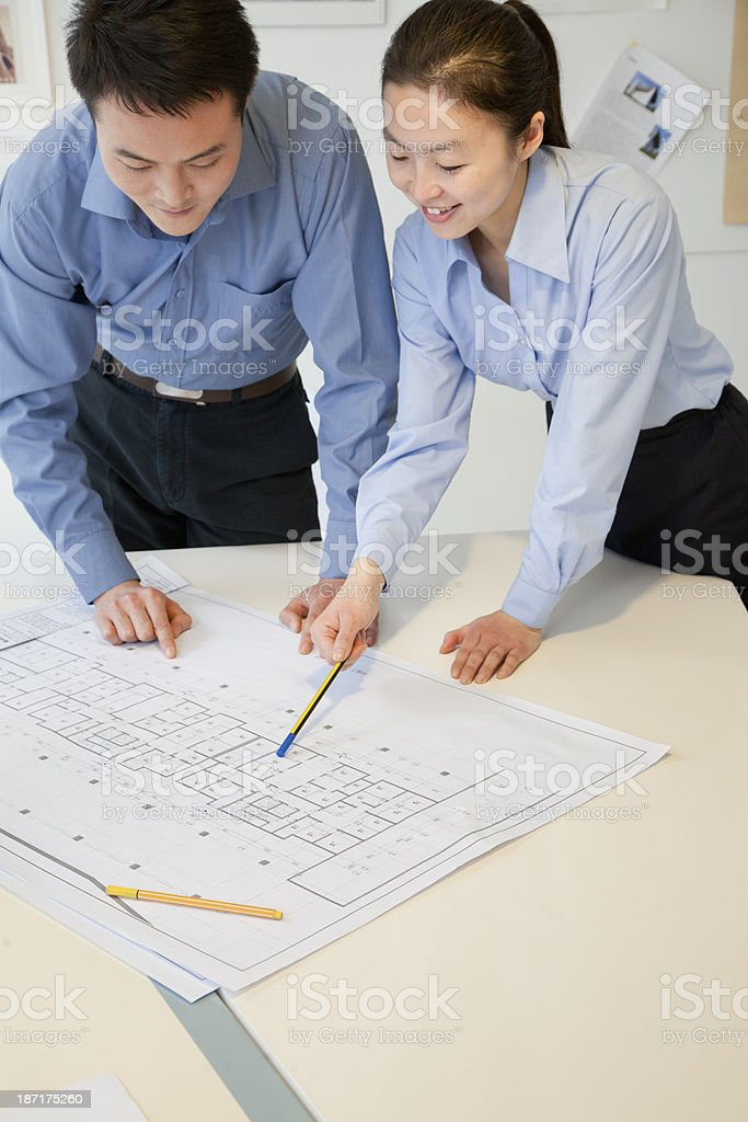 Coworkers discussing project in the office royalty-free stock photo