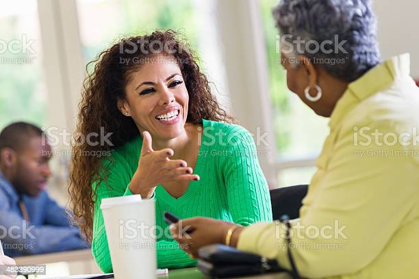Coworkers discussing something in work meeting picture id483390999?b=1&k=6&m=483390999&s=612x612&h=m9jbbz2jlll2siz3 b6doxzr22ty2bts7kqpqeeo5ga=