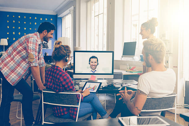 Coworkers doing a video conference in the conference room – Foto